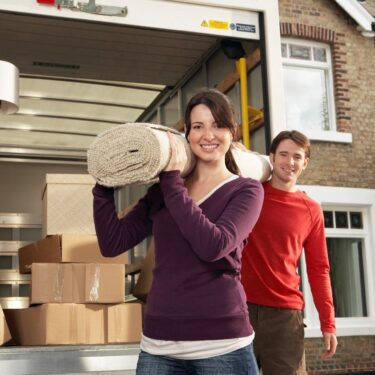 A man and a woman moving in their new Toronto home